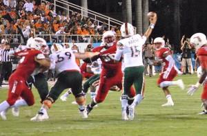 Florida Atlantic bringing pressure up the middle against Miami's quarterback Brad Kaaya.