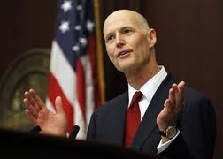 scott rick signing2 Scott repeats: Florida won't do optional parts of health law