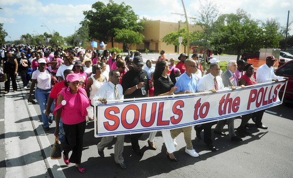 73081300 Hundreds march from black churches Sunday to vote early in Souls to the Polls rally
