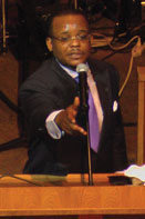 PINEY GROVE PASTOR SPEAKING Reverend Derrick J. Hughes celebrates his second year at Piney Grove