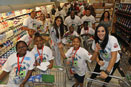 Fins and Kids MDWO member Reggie Bush, Dan Carpenter and Karlos Dansby host Fins and Kids Publix Shopping Spree