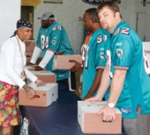 Miami Dolphins host multiple Thanksgiving  meal distributions throughout South Florida