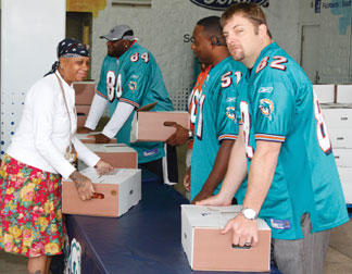 Miami Dolphins Miami Dolphins host multiple Thanksgiving  meal distributions throughout South Florida