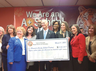 DOE check to Piper Governor Rick Scott, Superintendent Bob Runcie and 8 of the 9 Leading Ladies of the Broward County School Board.