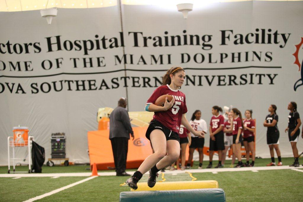 LR Pembroke Pines Player Participating at Dolphins Flag Football Clinic MIAMI DOLPHINS HOST GIRLS HIGH SCHOOL FLAG FOOTBALL CLINIC AT THE DOCTORS HOSPITAL TRAINING FACILITY