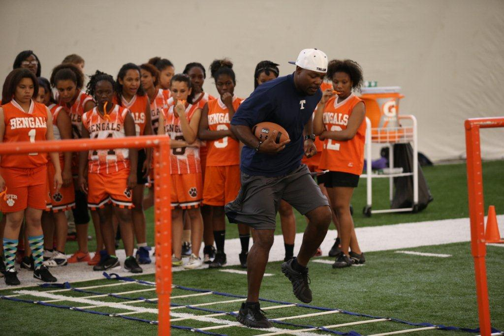LR Piper Bengals Girls Receiving Instruction at Miami Dolphins Flag Football Clinic MIAMI DOLPHINS HOST GIRLS HIGH SCHOOL FLAG FOOTBALL CLINIC AT THE DOCTORS HOSPITAL TRAINING FACILITY