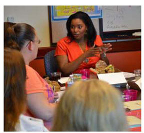 Vice Mayor Barbara Sharief speaks with group formed