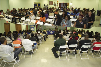 Citizens attend the Town Hall Meeting