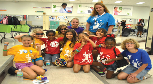 Adele Trizzino, YMCA Director Youth Development Director, with her little campers.