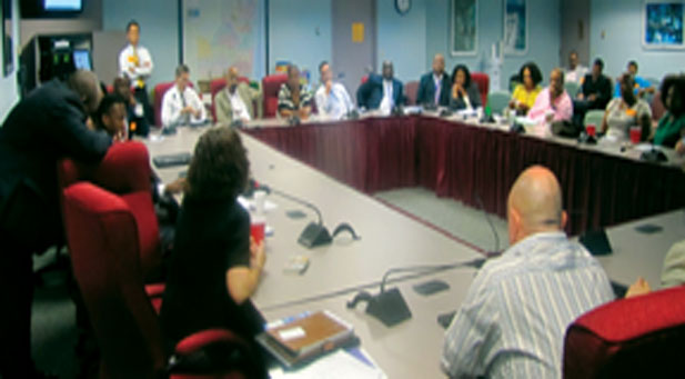 District 9 Broward County Commissioner Dale Holness challenged Wal-Mart representatives