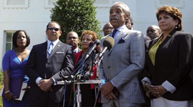Al Shaprton and other voting rights advocates speak with press