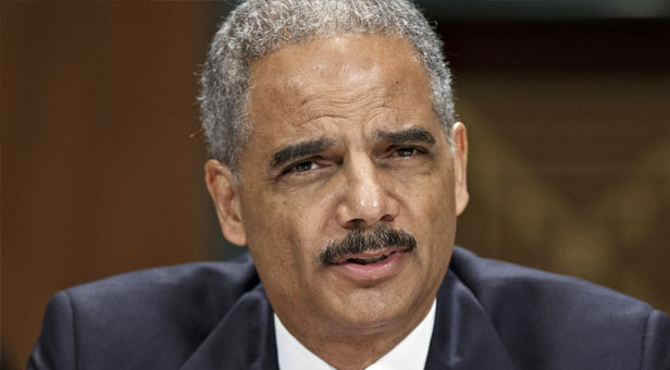 ERIC HOLDER Justice Department gets smart on crime