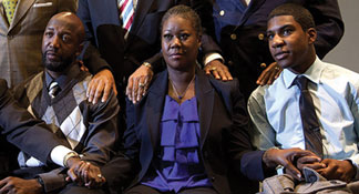 Trayvon's father Tracy Martin and mother Sybrina Fulton and brother Jahvaris Fulton