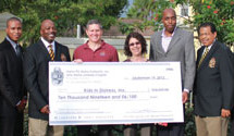 Alphas donate over $10,000 to Kids in Distress