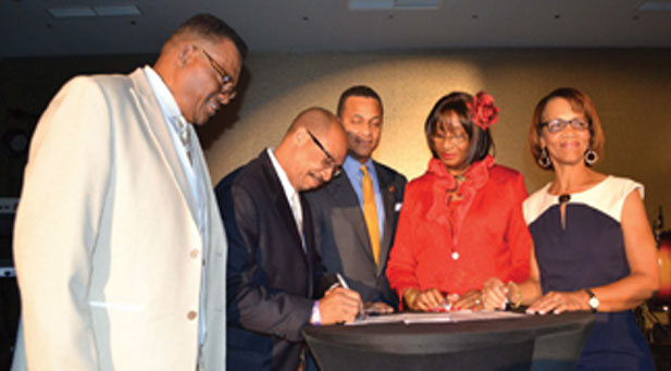 Bobby R. Henry, Sr. publisher of the Westside Gazette, Fort Lauderdale, Fla. Chairman of NNPA/HBCU Initiative, Texas Southern University's President, Dr. John Rudley, NNPA Chairman Clovis Campbell, Jr., publisher Arizona Informant, Co-chair Dorris Ellis Robinson, publisher The Houston Sun, and committee member Jacqueline Hampton, publisher of Mississippi Link.