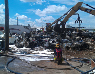YARD FIRE RESCUE QUICKLY EXTINGUISHES FIRE AT SCRAP METAL YARD