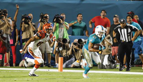 CB #21 Brent Grimes returned an interception 94 yards for a touchdown to put the Dolphins up 17-3 midway through the third quarter