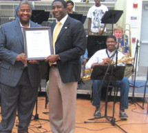 Commissioner Holness presents proclamation to Dillard High School Orchestra Director