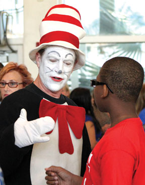 Cat in the Hat' greets a Dr. Martin Luther King, Jr. Elementary School student during the National Day of