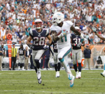 The Miami Dolphins  (8-6) win third game in a row to help their wild-card chances