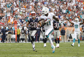 Wallace The Miami Dolphins  (8 6) win third game in a row to help their wild card chances