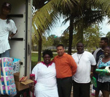 Essie 'Big Mama' Reed, Mr. Frank Tirotta, operations supervisor, Racetrac, delivers gifts