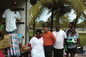 BIG MAMA Essie Big Mama' Reed, Mr. Frank Tirotta, operations supervisor, Racetrac, delivers gifts