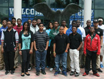 "100 Black Men of Greater Fort Lauderdale mentees pose in front of the home of FGCU's ""Dunk City"" gymnasium –"