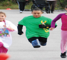 CHILDREN'S DIAGNOSTIC & TREATMENT CENTER PATIENT, 10-YEAR-OLD DOUBLE AMPUTEE, BRIAN DOUGLAS INSPIRED CROWD AT 5K 4 KIDS RACE