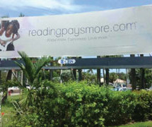 Billboard created by Dillard High School students inspire their fellow students to read more, earn more, and love more
