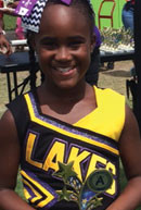 Oshene Whittick received the Athlete Scholar Award by the Lauderdale Lakes Viking Football and Cheerleading squad