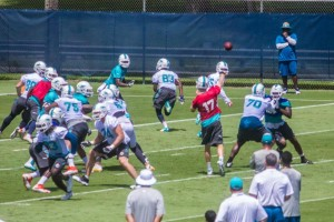 Jun 16, 2015; Miami, Fla. USA; Ryan Tannehill (17) throws from the huddle at Miami Dolphins mini camp.