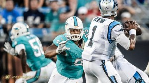 Miami Dolphins defensive tackle Ndamukong Suh chasing after Carolina Panthers quarterback Cam Newton