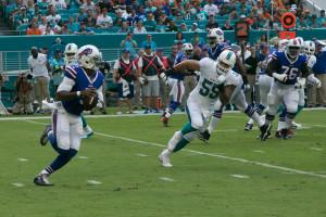 Maimi Dolphins linebacker Koa Misi (#55) chasing Tyrod Taylor (#5).  Shot by Ron Lyons.