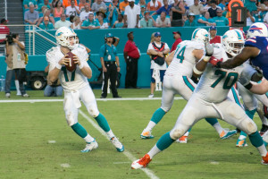 Miami Dolphins quarterback Ryan Tannehill (#17) drops back for a pass against the Buffalo Bills.  Shot by Ron Lyons.