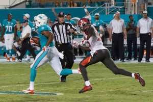 Christion Jones returns a kickoff for a touchdown for the Miami Dolphins. The play was later called back because of an illegal block penalty.
