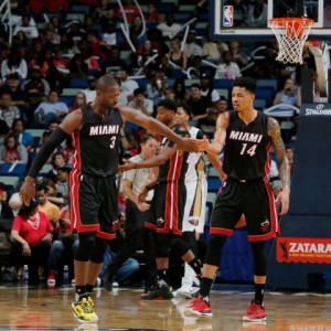 Dwyane Wade showing love to Gerald Green against the New Orleans Pelicans.  -Shot by the Miami Heat