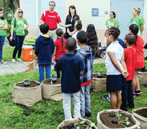 Local nonprofit receives boots to aid youth gardening program
