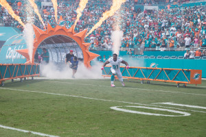Miami Dolphins defensive end Cameron Wake runs out on to the field. -Shot by Ron Lyons.