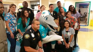 The Miami Dolphins pose with the staff at Baptist Hospital.