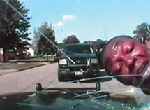 Police officer shatters windshield of his police cruiser with handcuffed man's face