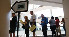 voters-wait-in-line-to-cast