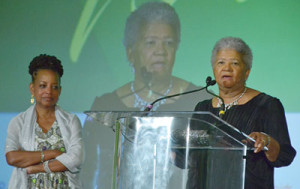Newly-elected NNPA Chairman Dorothy Leavell gives remarks during the 2017 NNPA Legacy Awards Gala as outgoing chair. Washington Informer publisher Denise Rolark Barnes looks on. (Roy Lewis/NNPA)