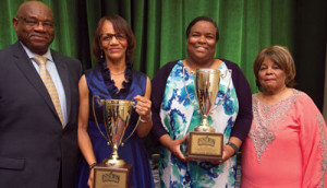 L to r: Al McFarlane, publisher of Insight News; Jackie Hampton, publisher of the Mississippi Link and winner of the Publisher of the Year, Kenya Vaughn, web editor of the St. Louis American, accepting the general excellence award; and Rosetta Perry, publisher of the Tennessee Tri-bune pose for a photo during the 2017 NNPA Merit Awards at the National Harbor in Prince George's County Md., on June 22, 2017.                        (Mark Mahoney/NNPA)