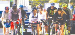 A2MIA bike riders: Qua (fourth from r), along with some of the celebrity bike riders.
