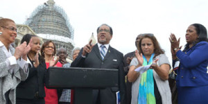 NNPA President Benjamin Chavis speaks outside of the U.S. Capitol during a joint press conference between NNPA and NAHP. The press conference was attended by Washington, D.C. Congresswoman Eleanor Holmes Norton in 2016. (far left). (Freddie Allen/AMG/NNPA)