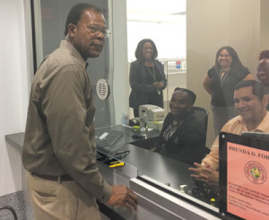 New Passport Office opens with Hot 105's Rodney Baltimore renewing his passport on opening day.