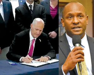 Governor Rick Scott signed into law legislation and Rep. Bobby DuBose.