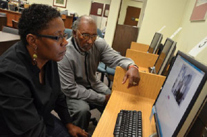 Peonage Researchers Antoinette Harrell and Johnny Lee Gaddy perusing the Florida State Archives.                 (Photo Credit: Walter Black, Sr.)