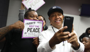 "Russell Simmons takes a selfie with a student from the Community Coalition's Freedom School, during RushCard's ""Keep The Peace"" initiative at the University of Southern California. (Andre L. Perry/Los Angeles Sentinel)"